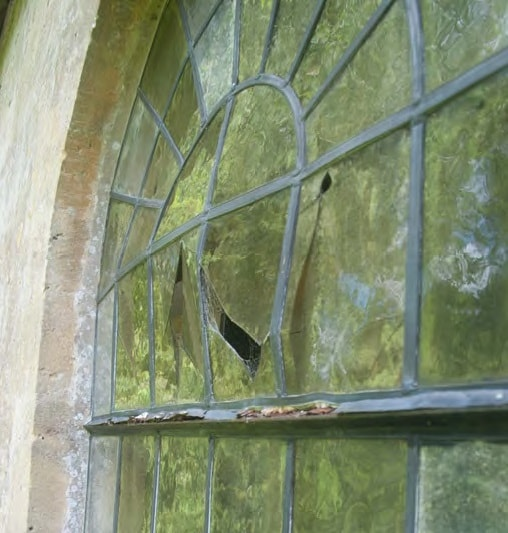 The window at St Kenelm's, Sapperton, before repairs